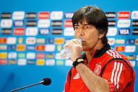 Germany manager Joachim Low drinks water during the press conference
