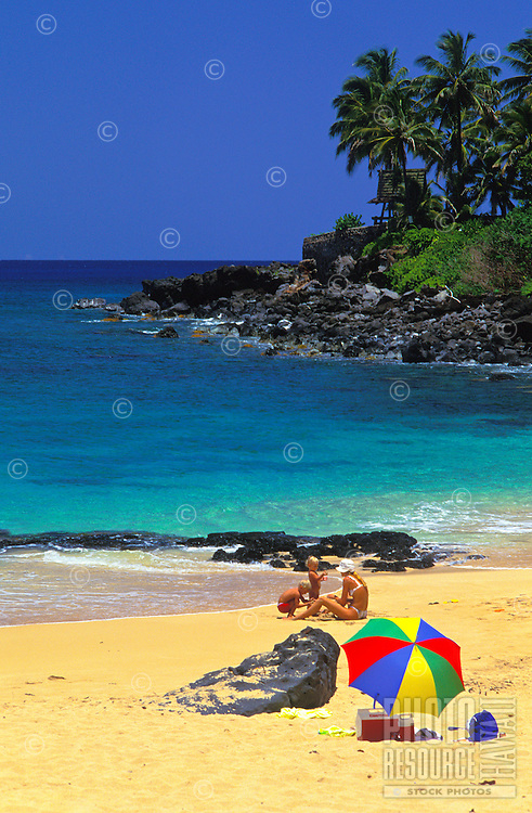 People enjoying the beach at Waimea Bay