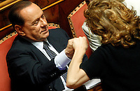 Il leader del PdL Silvio Berlusconi saluta la senatrice Paola Pelino durante la discussione sulla mozione di sfiducia nei confronti del Ministro dell'Interno e Vicepresidente del Consiglio al Senato, Roma, 19 luglio 2013.<br /> People of Freedom (PdL) party's leader Silvio Berlusconi greets Senator Paola Pelino, right, during a plenary session for the discussion of a no confidence motion against Interior Minister and Deputy Premier, at the Senate in Rome, 19 July 2013.<br /> UPDATE IMAGES PRESS/Riccardo De Luca