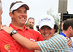 Rory McIlroy congratulates Lee Westwood after winning on the Final Day of the Dubai World Championship Golf in Jumeirah, Earth Course, Golf Estates, Dubai  UAE, 22nd November 2009 (Photo by Eoin Clarke/GOLFFILE)