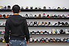 A wall of sneakers at Saint Alfred in the Wicker Park neighborhood of Chicago. Photo by Kevin J. Miyazaki/Redux