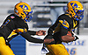 Chris Collier #22 of Lawrence, right, takes a handoff from quarterback #1 Christian Fredericks during the Nassau County Conference III varsity football semifinals against Bethpage at Hofstra University on Saturday, Nov. 11, 2017. Collier carried 30 times for 217 yards and two touchdowns (90 and 64 yards) in Lawrence's 35-13 win.