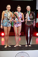 (L-R) Vera Sesina (silver), Evgeniya Kanaeva (gold) of Russia and Anna Bessonova of Ukraine are winners in All Around at 2009 World Cup at Portimao, Portugal on April 18, 2009.  (Photo by Tom Theobald).