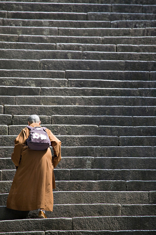 Woman walking up steps at Chionin Temple in Kyoto Japan