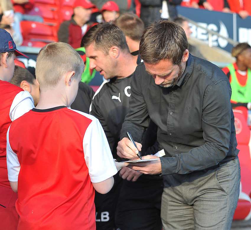 Fleetwood Town's Manager Graham Alexander signs a young fan's program<br /> <br /> Photographer Dave Howarth/CameraSport<br /> <br /> Football - Capital One Cup First Round - Fleetwood Town v Hartlepool United - Tuesday 11th August 2015 - Highbury Stadium - Fleetwood<br />  <br /> &copy; CameraSport - 43 Linden Ave. Countesthorpe. Leicester. England. LE8 5PG - Tel: +44 (0) 116 277 4147 - admin@camerasport.com - www.camerasport.com