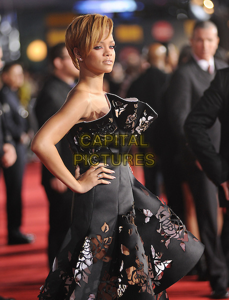 RIHANNA (Robyn Rihanna Fenty).The 2009 American Music Awards held at The Nokia Theatre L.A. Live in Los Angeles, California, USA. .November 22nd, 2009.AMA AMA's half length black white strapless dress cut out away perforated floral print couture hand on hip.CAP/RKE.©DVS/RockinExposures/Capital Pictures