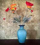 Fake flowers in a blue vase Los Angeles, CA. July 25, 2014.
