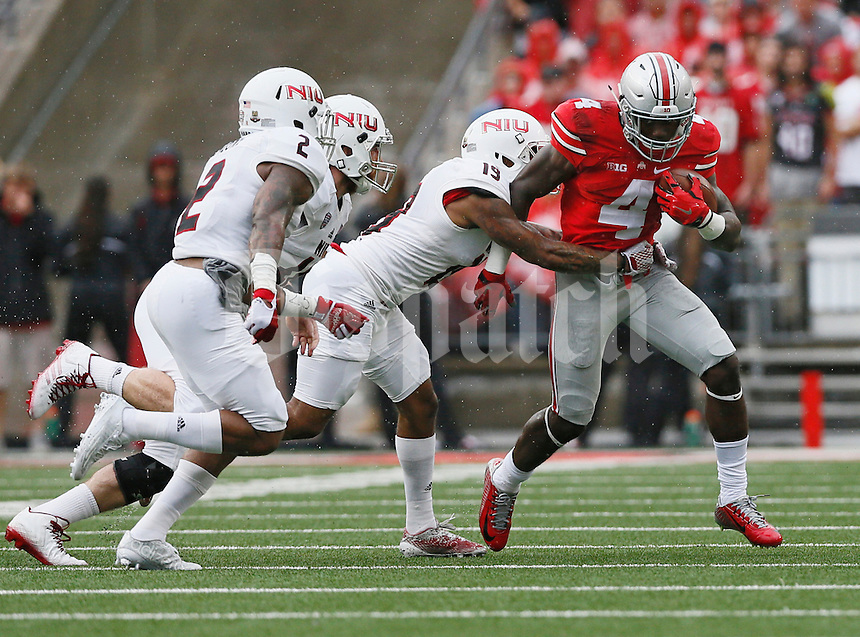 Ohio State Buckeyes running back Curtis Samuel (4) is tackled by Northern Illinois Huskies cornerback Shawun Lurry (19) during the first quarter of the NCAA football game at Ohio Stadium in Columbus on Sept. 19, 2015. (Adam Cairns / The Columbus Dispatch)