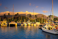 Lahaina Harbor at sunset with the West Maui Mountains in the background. From 1820-circa.1860, Lahaina was the whaling capital of the world with over a hundred whaling ships anchored in the harbor at any given time.