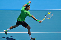 MELBOURNE, 14 JANUARY - Jo-Wilfried Tsonga (FRA) hits a backhand in a match against Jurgen Melzer (AUT) on day three of the 2011 AAMI Classic at Kooyong Tennis Club in Melbourne, Australia. (Photo Sydney Low / syd-low.com)