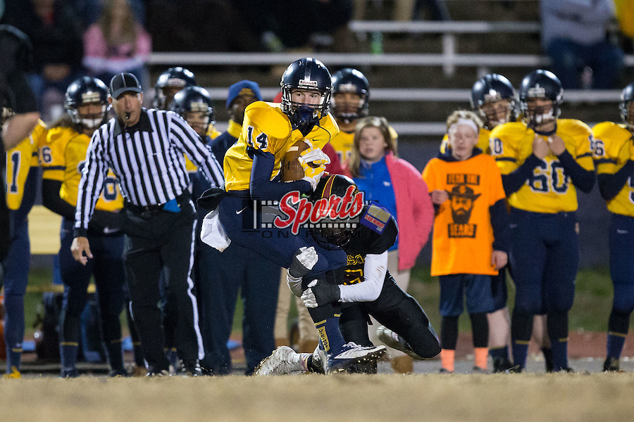 Trey Page (14) of the South Iredell Vikings is tackled by Bakaar Anderson (6) of the JM Robinson Bulldogs during second half action at South Iredell High School November 20, 2015, in Statesville, North Carolina.  The Vikings defeated the Bulldogs 14-13.  (Brian Westerholt/Special to the Tribune)
