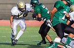 Torrance, CA 10/03/13 - unidentified South Torrance player(s) and unidentified Peninsula player(s) in action during the Peninsula vs South Torrance Freshmen football game at South Torrance High School.
