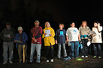 """Opponents of the death penalty hold a prayer vigil near the entrance to the Greensville Correctional Center hours before the 9 p.m. execution of John Allen Muhammad, the so-called """"Washington sniper"""" responsible for gunning down 10 and wounding three in the D.C.-area in 2002, in Jarratt, Virginia on November 10, 2009.  Virginia Governor Tim Kaine refused to grant a stay of clemency and the U.S. Supreme Court turned down the request for a stay of execution despite religious objections due to Muhammad's mental health."""