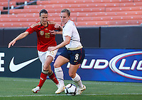 22 MAY 2010:  Germany's Sonja Fuss #15 and USA's Amy Rodriguez  #8 during the International Friendly soccer match between Germany WNT vs USA WNT at Cleveland Browns Stadium in Cleveland, Ohio. USA defeated Germany 4-0 on May 22, 2010.