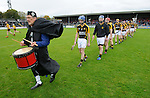 Stan Lineen of Ballyea leads out his team for the senior hurling county final at Cusack park. Photograph by John Kelly.