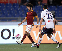 Calcio, Serie A: Roma vs Bologna. Roma, stadio Olimpico, 11 aprile 2016.<br /> Roma's Mohamed Salah, left, is challenged by Bologna's Adam Masina during the Italian Serie A football match between Roma and Bologna at Rome's Olympic stadium, 11 April 2016.<br /> UPDATE IMAGES PRESS/Isabella Bonotto