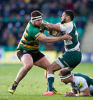 Telusa Veainu of Leicester Tigers looks to fend Kieran Brookes of Northampton Saints. Aviva Premiership match, between Northampton Saints and Leicester Tigers on April 16, 2016 at Franklin's Gardens in Northampton, England. Photo by: Patrick Khachfe / JMP
