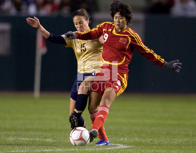 National team of China forward Han San (9) battles US WNT player Kate Markgraf (15). The US Women defeated China 1-0 at Home Depot Center stadium in Carson, California on Saturday December 13, 2008. Photo by Michael Janosz