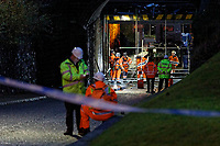 Pictured: Contractors work on the bridge where a double decker bus crashed. Thursday 12 December 2019<br /> Re: Police and fire service personnel have attended the scene of an accident involving a double decker bus that crashed under a railway bridge in the Hafod area of Swansea, Wales, UK.