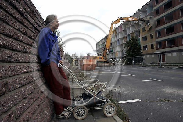 EISENH?TTENSTADT - GERMANY-- 14 - SEPTEMBER - 2005 -- An elderly woman watching as empty housing blocks are being demolished. She has lived in Eisenhuettenstadt since 1946 when her family was forced to leave the German area of Poland. -- Eisenhuettenstadt formaly known as the Stalinstadt (till1961) has lost nearly half its population since the German reunification. Around 30000 inhabitants still remain in the city famous for its steelworks during the Communist era of GDR. -- PHOTO:  JUHA ROININEN / EUP-IMAGES