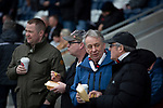 A group of home supporters enjoying a chat and refreshments inside the stadium before AFC Fylde took on Aldershot Town in a National League game at Mill Farm, Wesham. The fixture was played against the backdrop of the total postponement of all Premier League and EFL football matches due to the the coronavirus outbreak. The home team won the match 1-0 with first-half goal by Danny Philliskirk watched by a crowd of 1668.