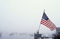 USA, Maine, Stonington, US flag on  fishing pier in fog