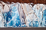 The blue ice of Glacier Viedma stands out vividly in the late morning light.  Glacier Viedma is located in the Northern Parque Nacionales los Glaciares, Argentina.