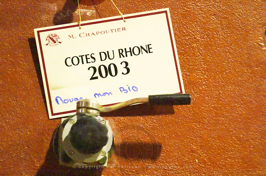 In the Chapoutier winery. A concrete fermentation vat with a sign saying it contains  Cotes du Rhone 2003 red wine  Domaine M Chapoutier, Tain l'Hermitage, Drome Drôme, France Europe