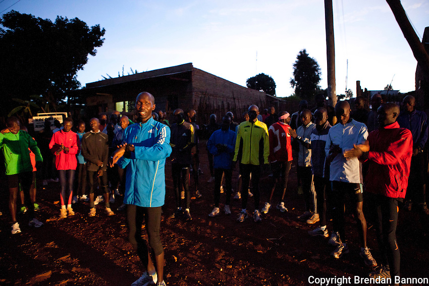 Wilson Kipsang, in blue, begins the morning run with his group  of athletes. Young unknown athletes train beside world class runners like Kipsang in Iten, Kenya.