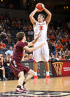 Virginia guard Thomas Rogers (30) shoots the ball during the game Tuesday in Charlottesville, VA. Virginia defeated Virginia Tech73-55.