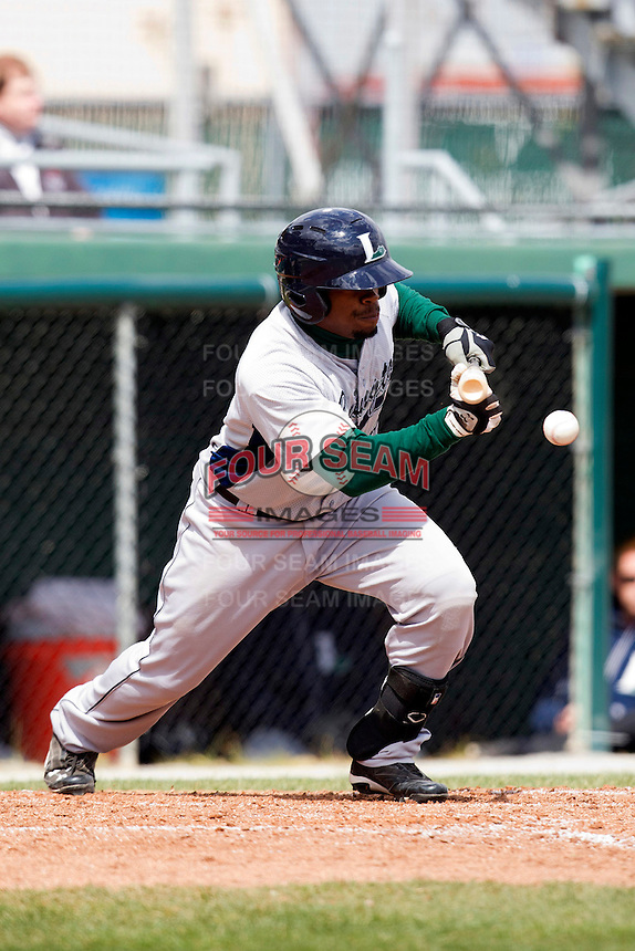 Lexington Legends second baseman Delino DeShields Jr #4 attempts a bunt during a game against the Hagerstown Suns at Municipal Park on April 11, 2012 in Hagerstown, Maryland.  Lexington defeated Hagerstown 3-0.  (Mike Janes/Four Seam Images)