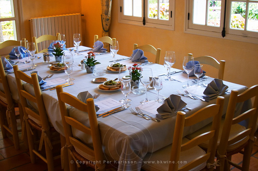 In the restaurant in the Domaine de Cabasse hotel and restaurant. Provencal colours, blue table cloth and napkins, yellow chairs, big wine glasses. Domaine de Cabasse Hotel Restaurant, Alfred and Antoinette Haeni, Séguret, Seguret Cote du Rhone Vaucluse Provence France Europe