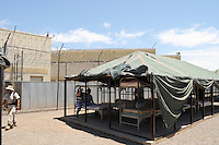 "Phoenix, Arizona - Established in 1993, the Maricopa County ""Tent City"" Jail has housed nearly 500,000 inmates. The outdoor facility houses both male and female inmates in old Korean War army tents. The jail exposes inmates to high temperatures during the summer. Inmates sleep under the tents and wear the old-fashioned jail uniform black-and-white stripes uniforms. These images correspond to the celebration of the 18th anniversary that took place in the same spot where Sheriff Arpaio announced in 1993 the establishment of this jail. A granite marker was unveiled to commemorate the 18th anniversary. ""Tent City"" has been a target of much criticism since its opening, but Sheriff Arpaio says the conditions there are similar to the situation for U.S. troops serving in Iraq and Afghanistan who also live in tents and under harsh climate conditions. Photo by Eduardo Barraza © 2011"