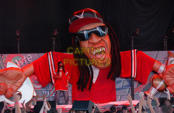 LIL JON.Live In Concert.at the Post-Gazette Pavilion,.Pittsburgh, 16th August 2005.full length stage gig rap rapper dred locks goatei beard mustache sunglasses hat red army military shirt denim jeans microphone hand arm fans model prop head bid giant.www.capitalpictures.com.sales@capitalpictures.com.© Capital Pictures.