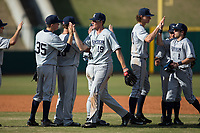 The Xavier Musketeers celebrate their win over the Penn State Nittany Lions in Game One of a double-header at Coleman Field at the USA Baseball National Training Center on February 25, 2017 in Cary, North Carolina. The Musketeers defeated the Nittany Lions 10-4.  (Brian Westerholt/Four Seam Images)