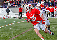 University at Albany Men's Lacrosse defeats Cornell 11-9 on Mar 4 at Casey Stadium.Long stick Fleet Wallace (#25) carries the ball.