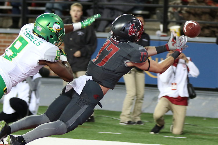 Kyle Sweet (17), Washington State wide receiver, stretches for a pass during the Cougars Pac-12 Conference game against the Oregon Ducks on October 1, 2016.   The Cougs defeated the Ducks at Martin Stadium, 51-33.