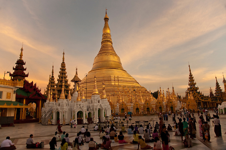 Worshippers at dusk-Shwedagon Paya,Yangon,Burma