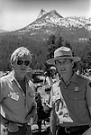 "Tuolumne Meadows, August 24, 1985:  Actor Robert Redford and Yosemite National Park Superintendent Bob Binneweis with Cathedral Peak in the background.  Mount Ansel Adams, an 11,700 foot peak in a remote section of Yosemite National Park was dedicated Saturday, August 24, 1985, in a ceremony recognizing the famed photographer for his contribution to the American conservation movement. Adams was eulogized as a man who dedicated his life to photography and the preservation of planet Earth. The dedication ceremony was led by Adams' son, Dr. Michael Adams of Fresno, and attended by Adams' widow, Virginia Adams, Secretary of the Interior Donald Hodel, Sen. Alan Cranston, D-California, National Park Service Director William Penn Mott, actor Robert Redford, and other environmental and conservation leaders. In 1932, Ansel Adams and several Sierra Club companions first climbed the peak, according to Virginia Adams, who added that ""Ansel loved its tower shape. He called it 'The Tower' on the Lyell Fork of the Merced River. After they came down from climbing it, they sat around the campfire and one of them suggested that they name it Mount Ansel Adams."" Informally, that is what the Sierra Club did, calling the peak Mount Ansel Adams in the Sierra Club Guide until 53 years later the peak was finally officially named.  Photo by Al Golub/Golub Photography"