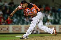 Jose Cobos pitcher relevo durante el juego de beisbol de Naranjeros vs Cañeros durante la primera serie de la Liga Mexicana del Pacifico.<br /> 15 octubre 2013