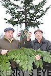 TREE: Dan Cronin and Liam Philpott of Milltown Community Council with the remains of the town's Christmas Tree which was badly vandalised last week.