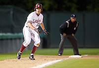 STANFORD, CA - March 29, 2011: Brian Guymon of Stanford baseball runs up the basepath toward home on a pitch during Stanford's game against St. Mary's at Sunken Diamond. Stanford won 16-14.