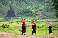 The ruins and Temples of Mrauk U, Rakhine State Myanmar Buddhist Monks on their way to their Monastery