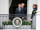 United States President Donald J. Trump and President Emmanuel Macron of France wAlk to the Blue Room Balcony to pose for a photo with first lady Melania Trump Brigitte Macron, following an arrival ceremony on the South Lawn of the White House in Washington, DC on Tuesday, April 24, 2018.<br /> Credit: Ron Sachs / CNP