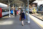 Rail passengers on platform of railway train station, Norwich, Norfolk, England, UK