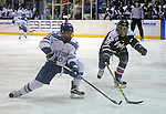 February 20, 2016 - Colorado Springs, Colorado, U.S. -   Air Force forward, Jordan Himley #10, and Robert Morris defender, Tyson Wilson #10, race for the puck during an NCAA ice hockey game between the Robert Morris University Colonials and the Air Force Academy Falcons at Cadet Ice Arena, United States Air Force Academy, Colorado Springs, Colorado.  Air Force defeats Robert Morris 4-1