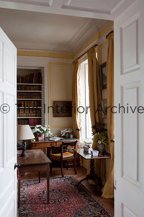 A glimpse through an open door from the entrance hall into the library