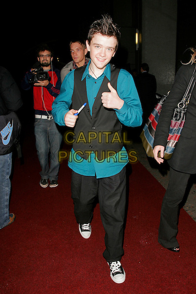 GEORGE SAMPSON.Leaving the Pride of Britain Awards, London Television Centre, South Bank, London, England, UK, .September 30th, 2008 .full length black waistcoat thumbs up hands teal shirt converse trainers .CAP/AH.©Adam Houghton/Capital Pictures.