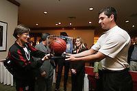 3 April 2008: Head coach Tara VanDerveer accepts a framed basketball at the Westin Harbour Island Hotel during Stanford's travel day to the 2008 NCAA Division I Women's Basketball Final Four in Tampa Bay, FL.