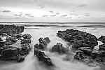 Iron shore and surf at sunrise along Jupiter Island, Palm Beach County, Jupiter, Florida